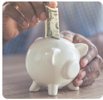 dollar billing going into piggy bank